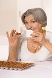Senior woman eats Royalty Free Stock Images