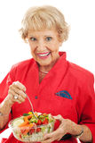Senior Woman Eats Salad Stock Photos