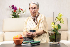 Senior woman electronic blood pressure check Stock Images
