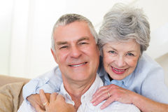 Senior woman embracing husband from behind Stock Photos
