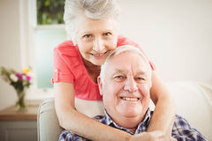 Senior woman embracing man at home Royalty Free Stock Photography