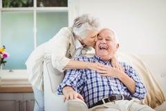 Senior woman embracing man at home Royalty Free Stock Images