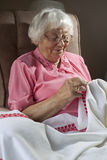 Senior woman embroidering Stock Images