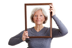 Senior woman with empty frame Stock Photo