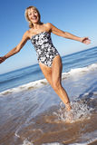 Senior Woman Enjoying Beach Holiday Royalty Free Stock Photo
