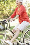 Senior Woman Enjoying Cycle Ride Stock Images