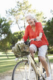 Senior Woman Enjoying Cycle Ride Stock Photography