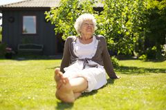 Senior woman enjoying the fresh air in garden Royalty Free Stock Photography