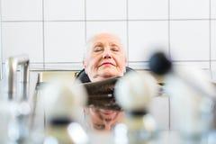 Senior woman enjoying mud bath Royalty Free Stock Photography