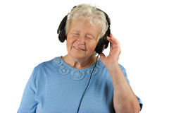 Senior woman is enjoying music Stock Photos