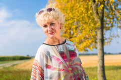 Senior woman enjoying the retirement outdoors in a sunny day in Stock Photography