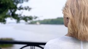 Senior woman enjoying river view in city park, looking in future, dreaming. Stock photo royalty free stock photography