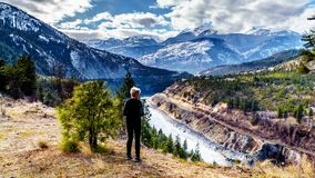 Senior woman enjoying the view of the Fraser Canyon Route following the Thompson River as it flows through the Coastal Mountain. Senior woman enjoying the view Stock Images
