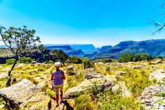 Senior woman enjoying the view of the highveld and the Blyde River Dam in the Blyde River Canyon Royalty Free Stock Photos