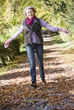 Senior woman enjoying walk through woods stock photos