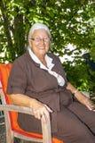 Senior woman enjoys sitting Royalty Free Stock Image