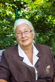 Senior woman enjoys sitting Stock Image