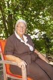 Senior woman enjoys sitting Royalty Free Stock Images
