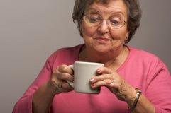 Senior woman Enjoys some Coffee stock photography