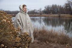 Senior woman enjoys a walk outdoors Royalty Free Stock Image