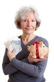 Senior woman with Euro money stock image