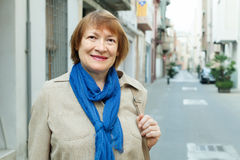 Senior woman at european town street Stock Photo