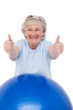 Senior woman on exercise ball with thumbs up Royalty Free Stock Photo