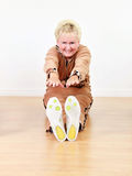 Senior woman exercise. An elderly happy woman stretching in an exercise class stock photo