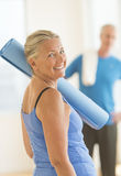 Senior Woman With Exercise Mat At Home Royalty Free Stock Photos