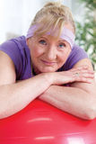 Senior woman after exercises relaxing Stock Images