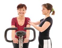 Senior woman exercises with trainer Stock Image