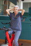 Senior woman exercising. On a spinning bicycle Stock Photo