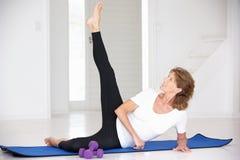 Senior woman exercising Royalty Free Stock Image