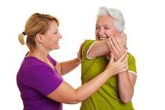 Senior woman exercising. Senior women exercising with personal fitness trainer Royalty Free Stock Image
