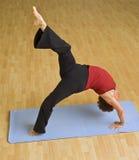Senior woman exercising. Senior woman  exercising doing bridge gymnastic Stock Image