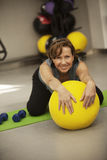 Senior woman exercising with ball Royalty Free Stock Photography