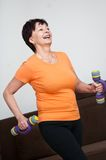 Senior woman exercising with barbells Royalty Free Stock Image