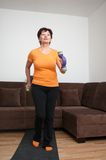Senior woman exercising with barbells Royalty Free Stock Images
