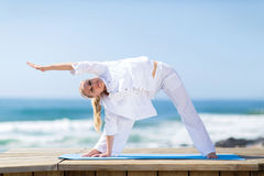 Senior woman exercising beach Stock Photo