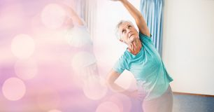Senior woman exercising with bokeh in foreground Stock Photography