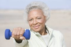 Senior Woman Exercising With Dumbbells Royalty Free Stock Photos