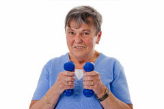 Senior woman exercising with dumbbells Stock Photos