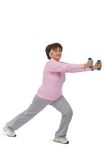 Senior woman exercising with dumbells Royalty Free Stock Photos