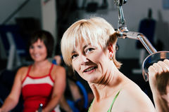 Senior woman exercising in gym Stock Photo