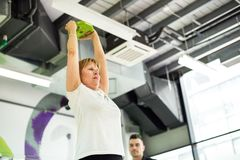 Senior woman exercising at gym Royalty Free Stock Images