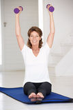 Senior woman exercising at home Stock Photography