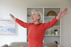 Senior woman exercising at home Royalty Free Stock Photos