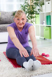 Senior woman exercising at home Royalty Free Stock Images
