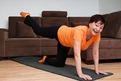 Senior woman exercising at home Royalty Free Stock Photography