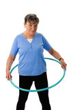 Senior woman exercising with hula-hoop Royalty Free Stock Image